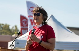 President Gayle Hutchinson smiles to a crowd as she addresses incoming freshmen to Chico State.