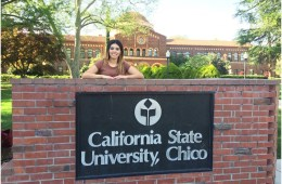Veronica Ledesma poses standing behind a Chico State sign made of bricks