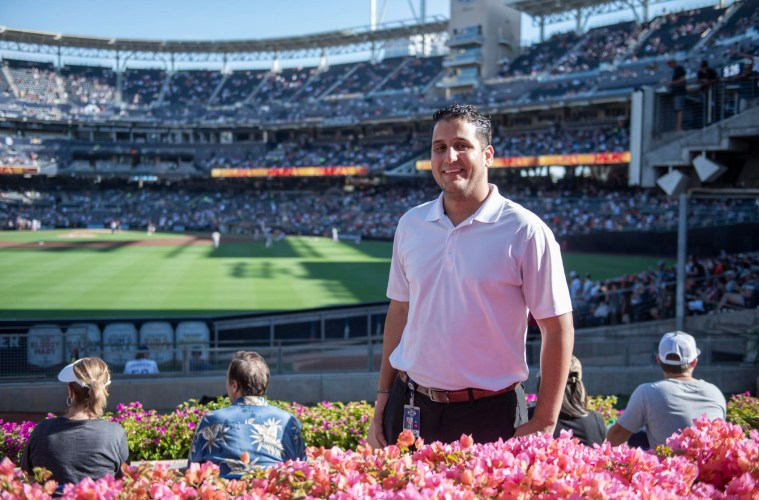 Rocky Dudum poses for a portrait in the stands of Petco Park.