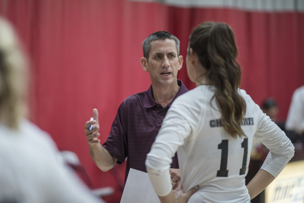 Cody Hein talks to a player during a match.