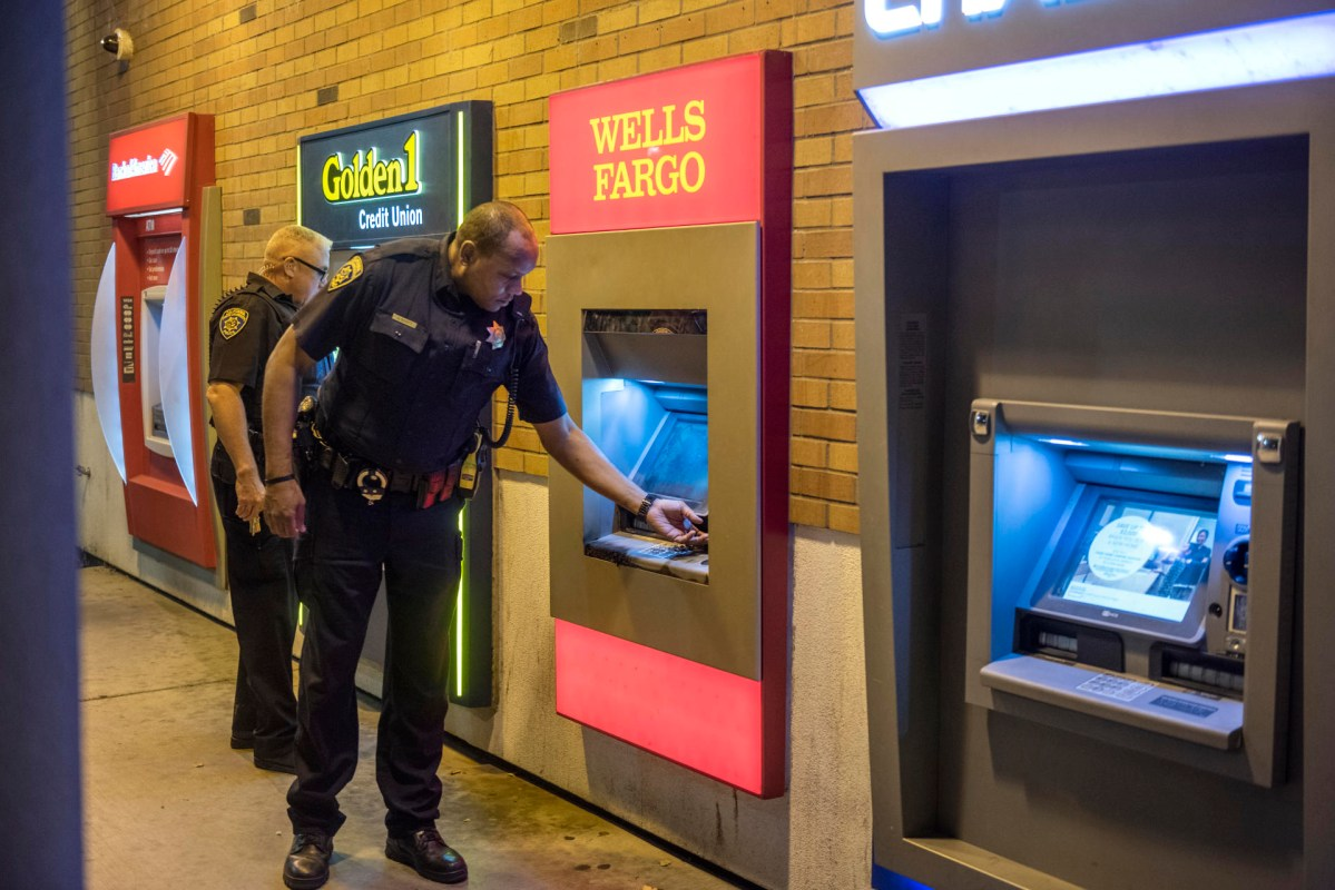 Scott and another university police officer check ATMs on campus.