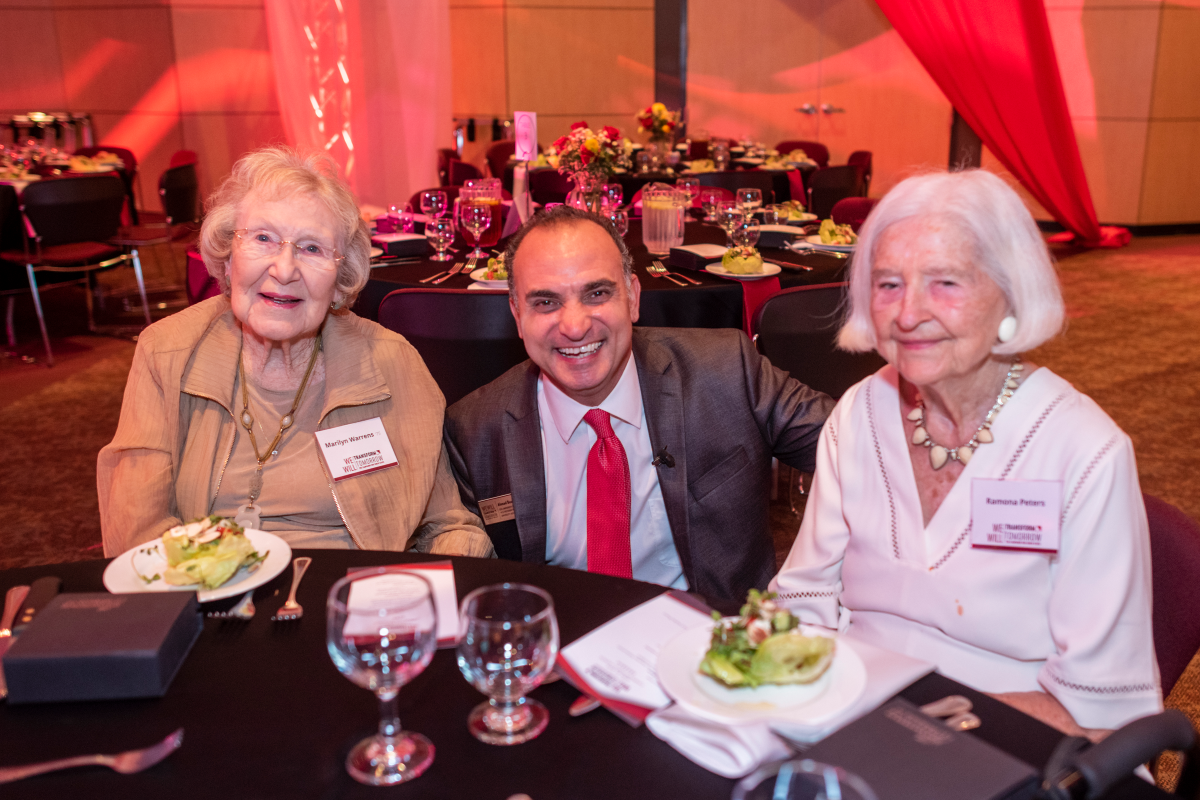 Marilyn Warrens sits with Ahmad Boura and another donor at the University's Campaign launch event.