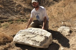 Russell Shapiro poses with the found 15-million-year-old whale vertebrae fossil in Simi Valley.