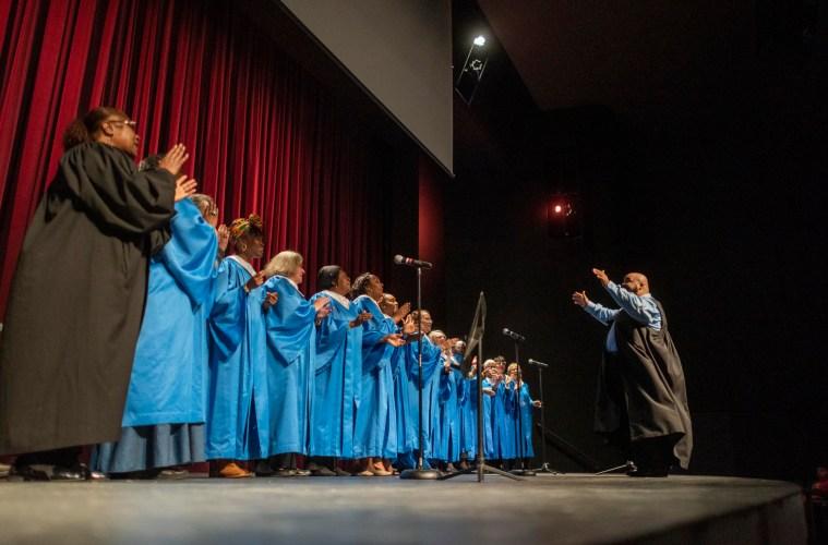 Gospel singers perform on stage.