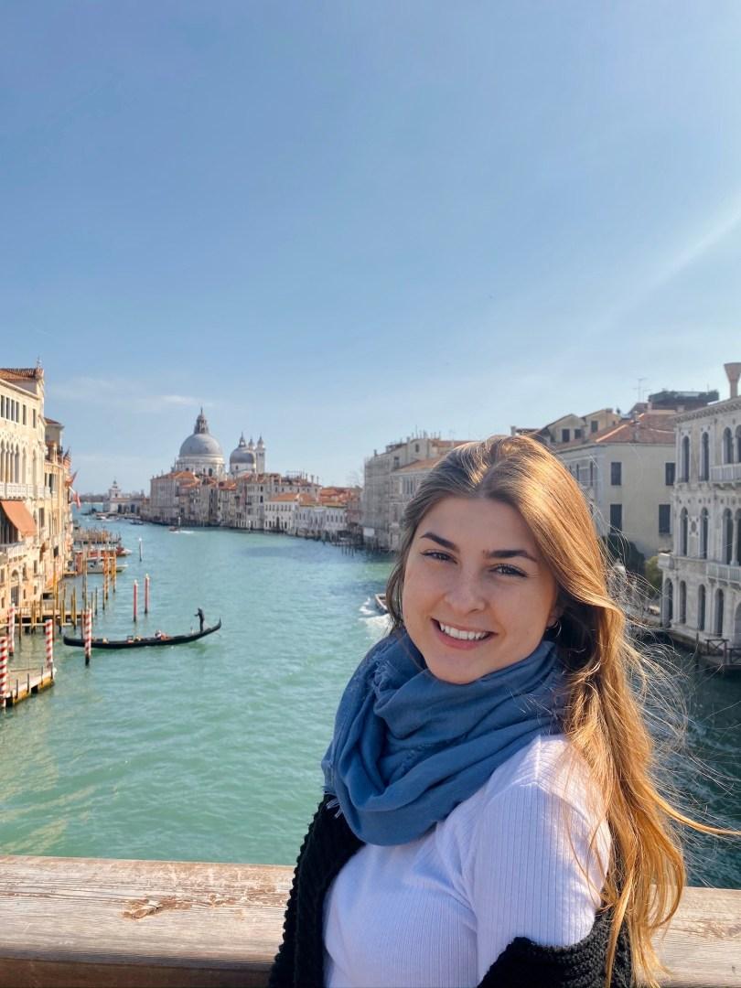 Alexandria poses near a Venice canal.