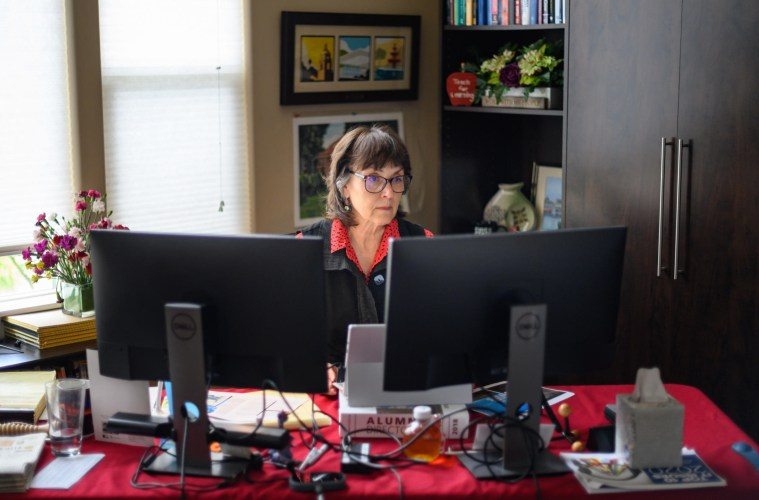 President Gayle Hutchinson sits in her home office, as she works from home like much of the rest of the University employees.