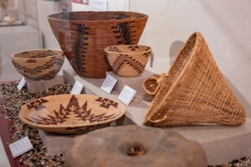 A collection of baskets from four generations of Mountain Maidu Weavers of the Meadows-Baker Family sits in the Valene L. Smith Museum.