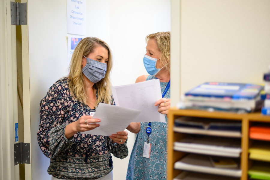 Elyse Fontana and Ann Dickman  work on COVID-19 contact tracing efforts with the Butte County Public Health office.