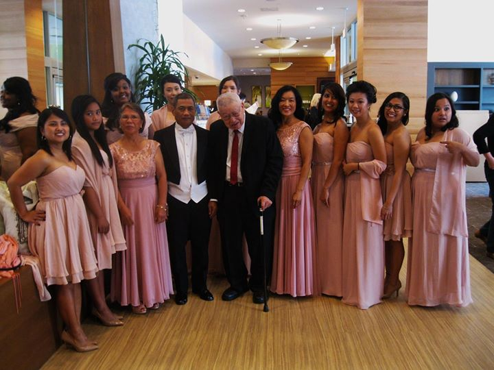Chew and his family pose in a line at a wedding.