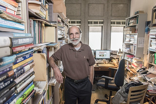 Michael Perelman poses for a portrait in his on-campus office.