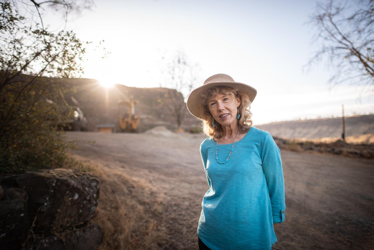 Cindy Wolff poses for a portrait near the rebuild of her home.