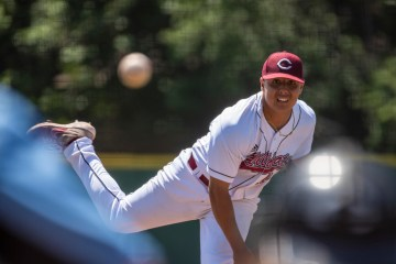 A Chico Sate baseball pitcher hurls a pitch toward a batter.