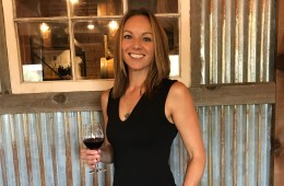 Winemaker Vanessa Pitney holds a glass of wine at her winery.