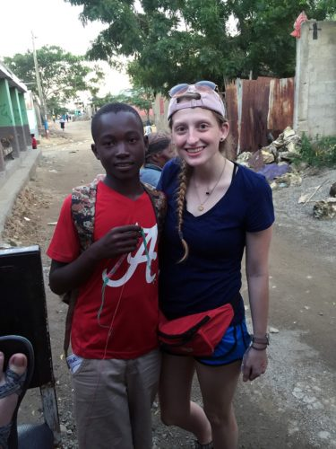 Avery Young (right) interacted with children regularly while in Haiti.