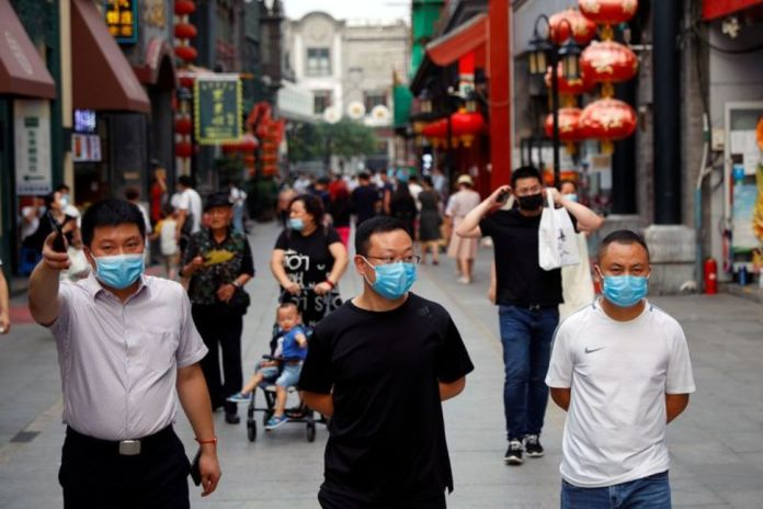 China Witnesses a Surge in COVID-19 Cases, Restricts Overseas Travel