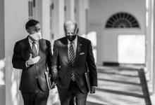 President Joe Biden walks with National Security Adviser Jake Sullivan along the Colonnade of the White House Friday