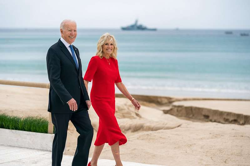 President Joe Biden and First Lady Jill Biden walk along the beach at the Carbis Bay Hotel and Estate for the G7 welcome ceremony Friday