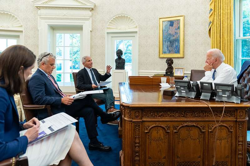 President Joe Biden, joined by Chief Medical Adviser to the President Dr. Anthony Fauci, reviews remarks he will give on COVD-19 and the economy on Tuesday, July 27, 2021, in the Oval Office of the White House. (Official White House Photo by Adam Schultz)