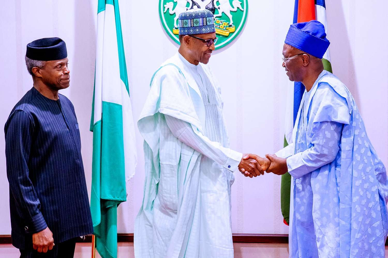 President Buhari receives copies of judgement of the presidential election petitions tribunal from Lead Counsel of his legal team
