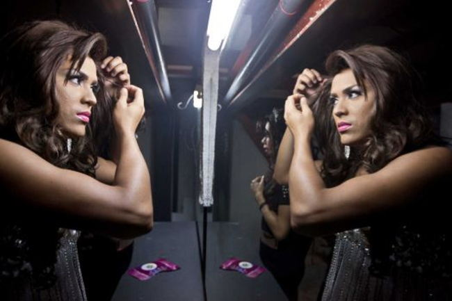 n this Saturday, June 21, 2014 photo, this year's winner of Miss Gay Nicaragua, Carlos Castro, is reflected in a mirror as he does his makeup for his crowning and presentation ceremony in Managua, Nicaragua. Castro, who represented the province of Leon, received a tiara valued for $2,000, a $5,000 cash prize and the opportunity to travel to Thailand as Nicaragua's representative in Miss Queen International.