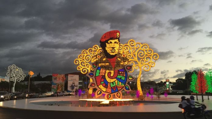 Former Venezuelan President Hugo Chávez is lined by the trees of life and some other psychedelic stuff