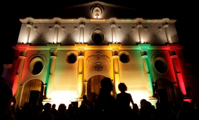 Colours light up Iglesia y Convento at night in Granada, Nicaragua.