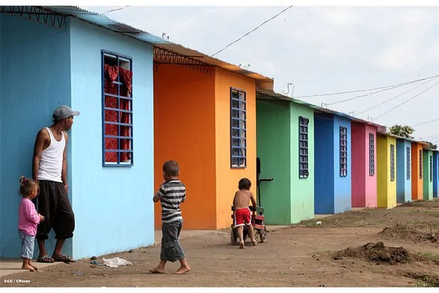 Families moving into new houses in Cuidad Belen