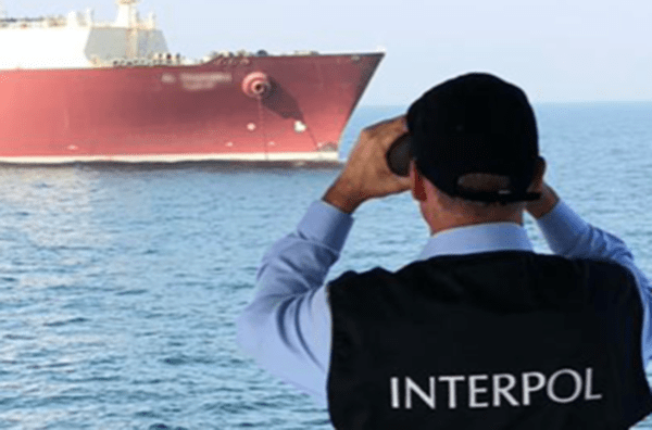 Marine Pollution - Interpol Agent with Binoculars