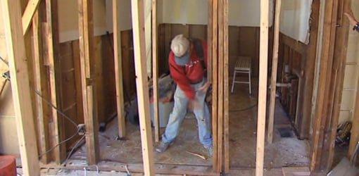 Carpenter removing wall.