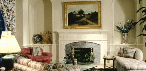 Decorated living room with fireplace mantel