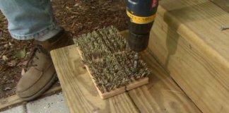 Screwing scrub brush to steop for boot scraper.