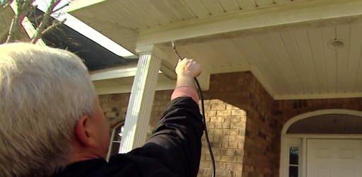 Using a pump up sprayer to clean vinyl trim.