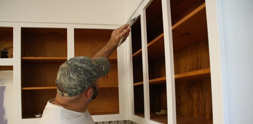 Painting kitchen cabinets.