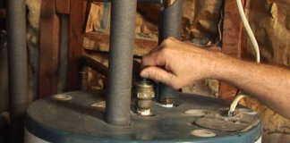 Closing the pressure relief valve on a hot water heater.