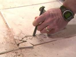 Removing cracked floor tile