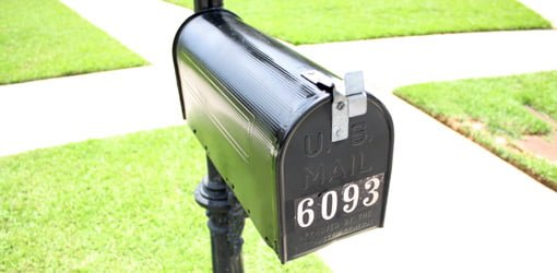 Black mailbox with 6093 number on it.