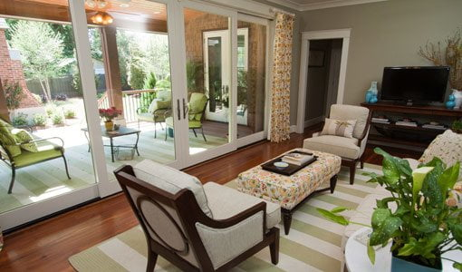 Kuppersmith house family room looking out through glass doors to porch.