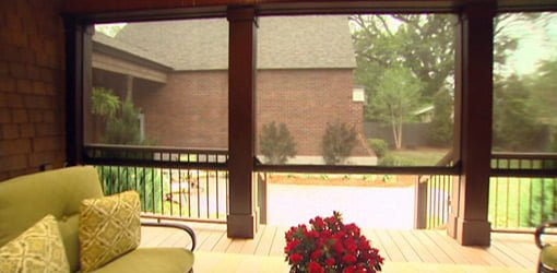 Retractable motorized screens on the Kuppersmith house porch.