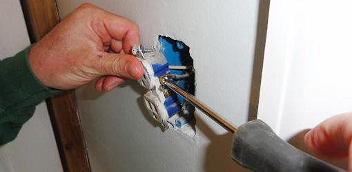 Disconnecting the wires from the receptacle.