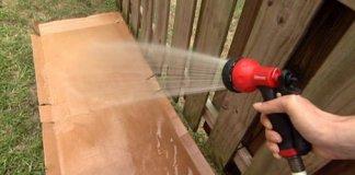 Spraying cardboard with hose