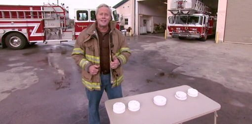 Danny Lipford at fire station with smoke alarms.