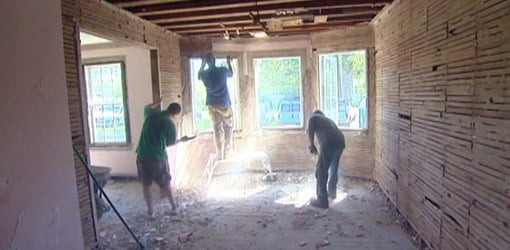 Removing the old plaster and lath from Kuppersmith home.