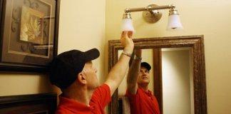 Joe Truini screwing in a light bulb!