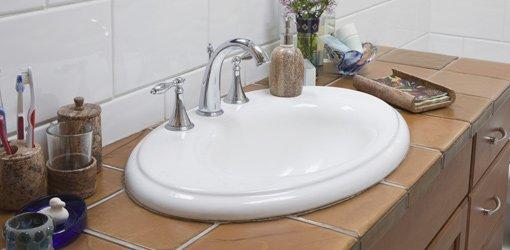 Bathroom vanity sink with faucet.