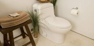 One-piece toilet with elongated bowl.