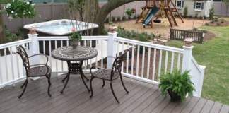 Completed backyard makeover with composite deck, hot tub, and playset.