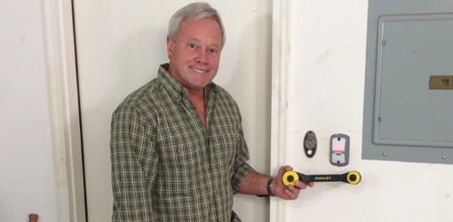 Danny Lipford with Genie garage door opener, Stanley TwinTec adjustable wrench, and NuTone College Pride Doorbell.