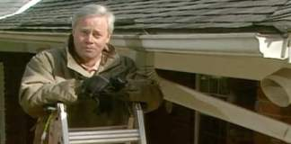 Danny Lipford on ladder with gutters.