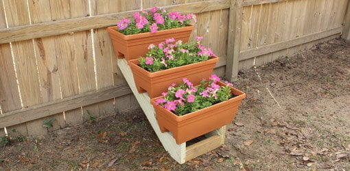 DIY stepped plant container display rack made from stair stringers.