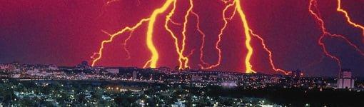 Lightning striking city.